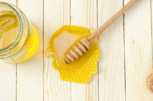picture of honey and honey spoon